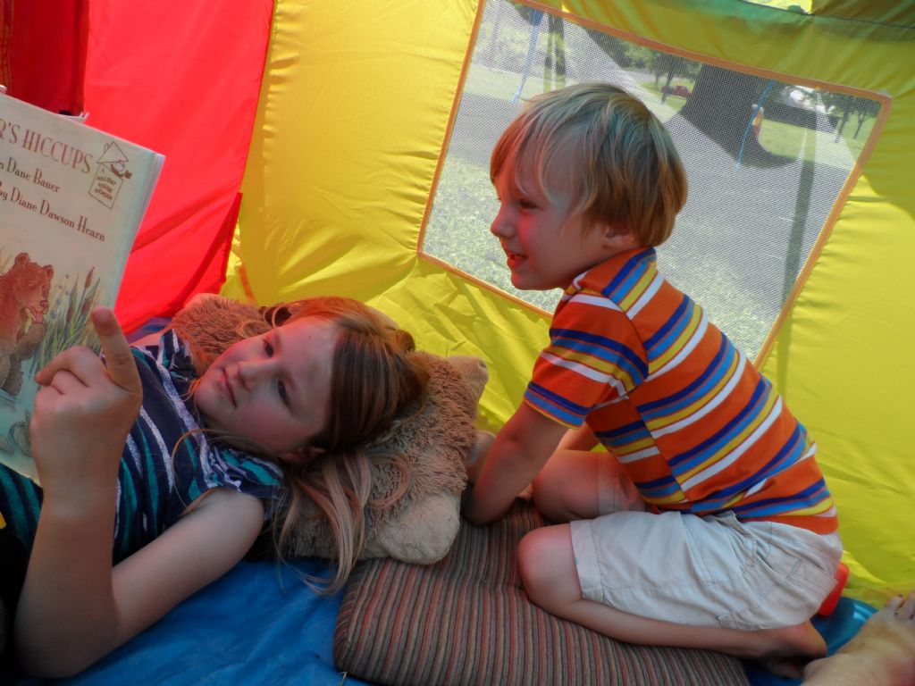 Reading in their tent